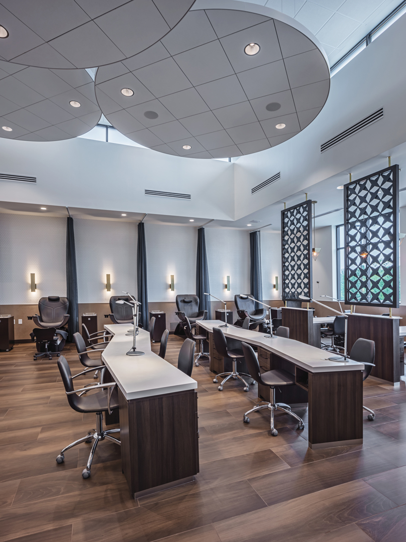 In the Nail Zone, community tables are available for polishing and drying. Pedicures are offered in the same space.