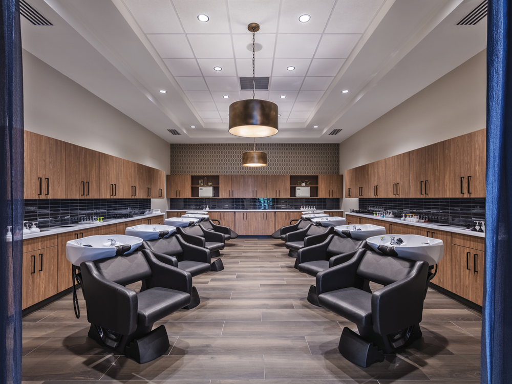 The salon's Lather Lounge features shampoo bowls with cushioned neck rests and foot rests. Two lay-down shampoo stations are available for longer scalp treatments.