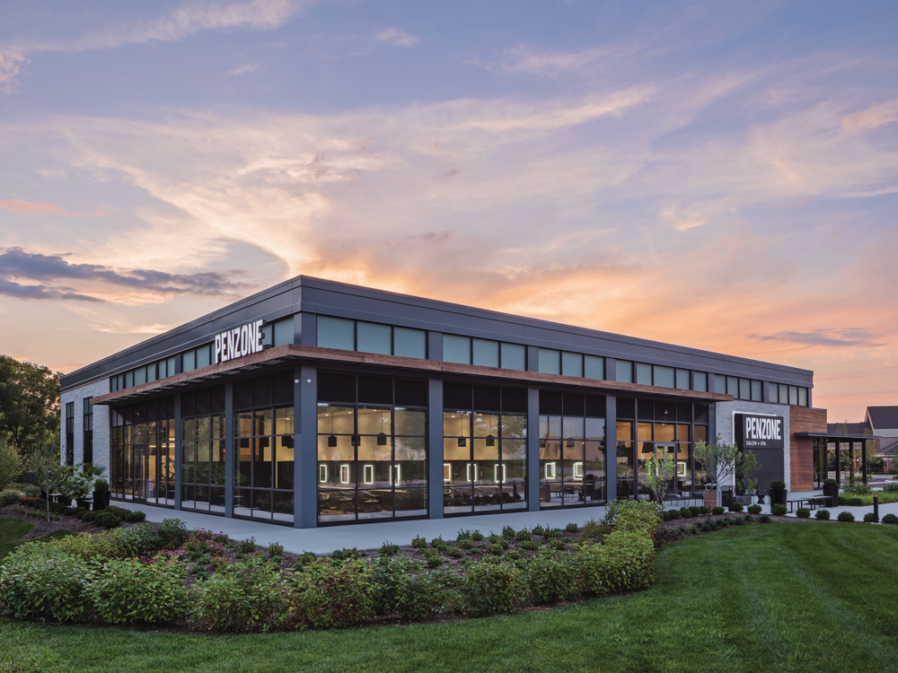 This architectural rendering of the new PENZONE Salon + Spa in Dublin, Ohio, shows the banks of windows that allow flood the salon with natural light.