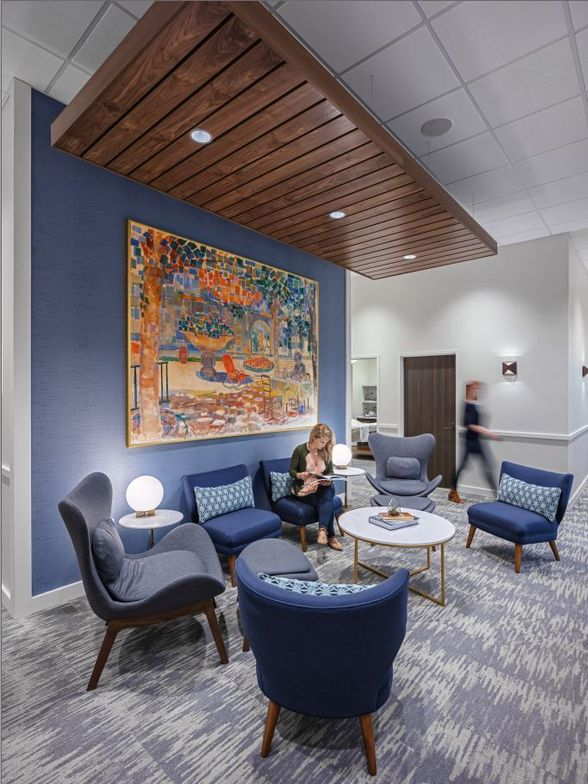<p>Lavish art, a wall of blue and matching furniture create a welcoming reception area for clients at Penzone Salon + Spa in Dublin, Ohio.</p>
