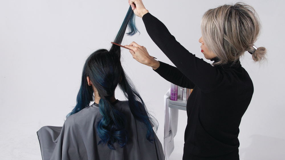 <p><strong>STEP 7 : </strong>Once you have your right side S in place, backcomb the rest of the hair and gather it back off the face. Twist and secure into base you created in the ponytail.</p>