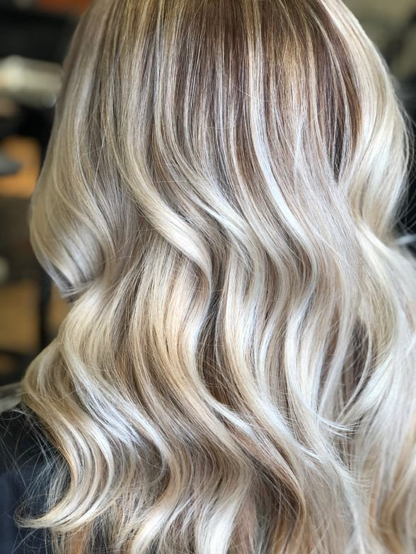 <p><strong>Midway through this client's transition to silvery blonde hair, Maria Rivera, @mariathehairpainter balayged the hair with LAKMÉ Clay Lightener + 3- volume developer (20-volume on compromised ends) and toned with LAKMÉ k.blonde Pearl Toner.</strong></p>
