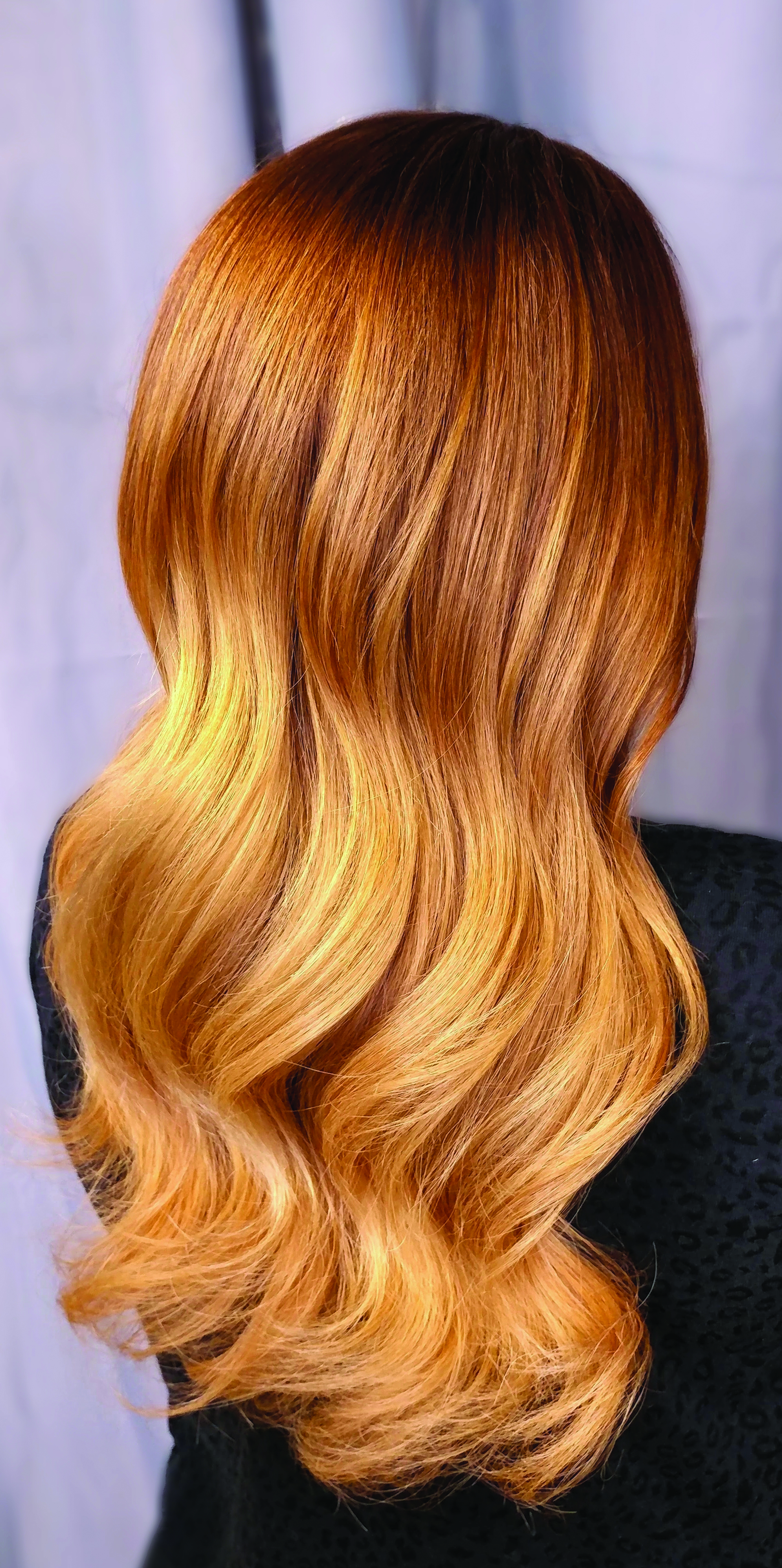 Golden hair gleams with dimensional color.
