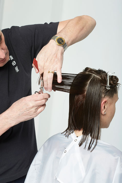 4. Once above the occipital, take one-inch vertical sections. Pull out from the head and cut to connect the new length and to leave long layers. Blend around the sides, directing back and cutting to the guide.