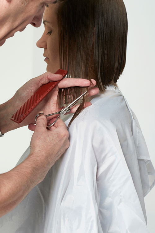 6. Bring the sides down to connect with the back. Finger angle should be forward to leave length toward the face.