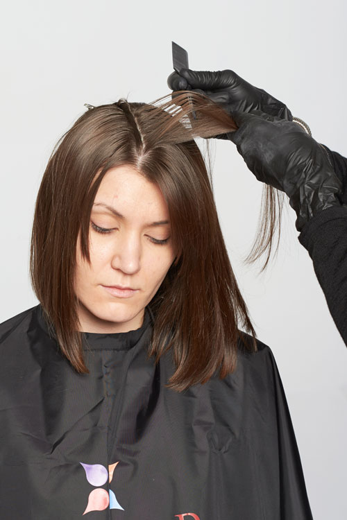 2. Begin highlights from below the isolated section. Take a fi ne sub-section and weave out selected strands.