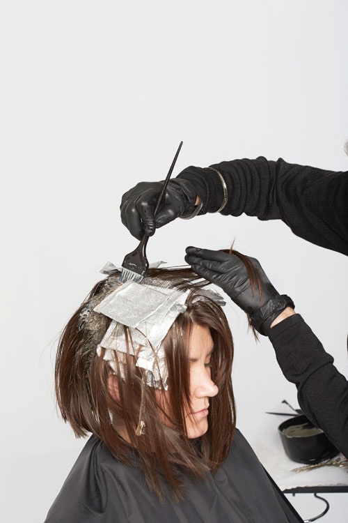 7. Once foils are in place, apply base color: 3NW (3.03) + 3N (3.0) with equal parts 10-volume (3%) ColorInsider Oil-In-Cream Developer for a deep natural dark brown.
