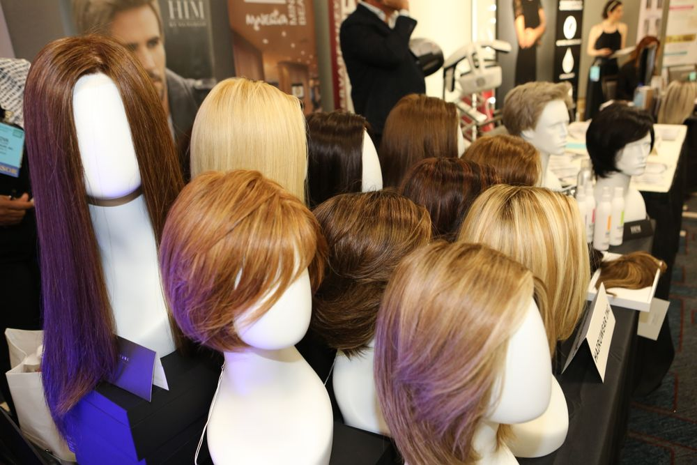 Hair systems at the HairUWear Professional table in the sponsor display area.