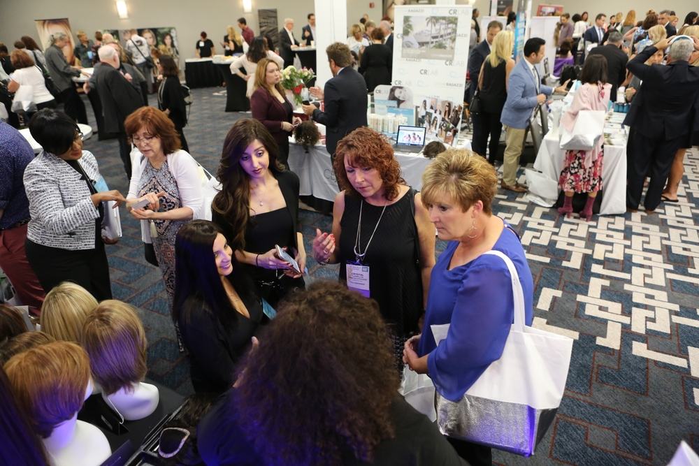 A bustling sponsor display area during a networking break. Attendees had the opportunity to connect during breaks for lunch as well as a networking reception at the end of day one.