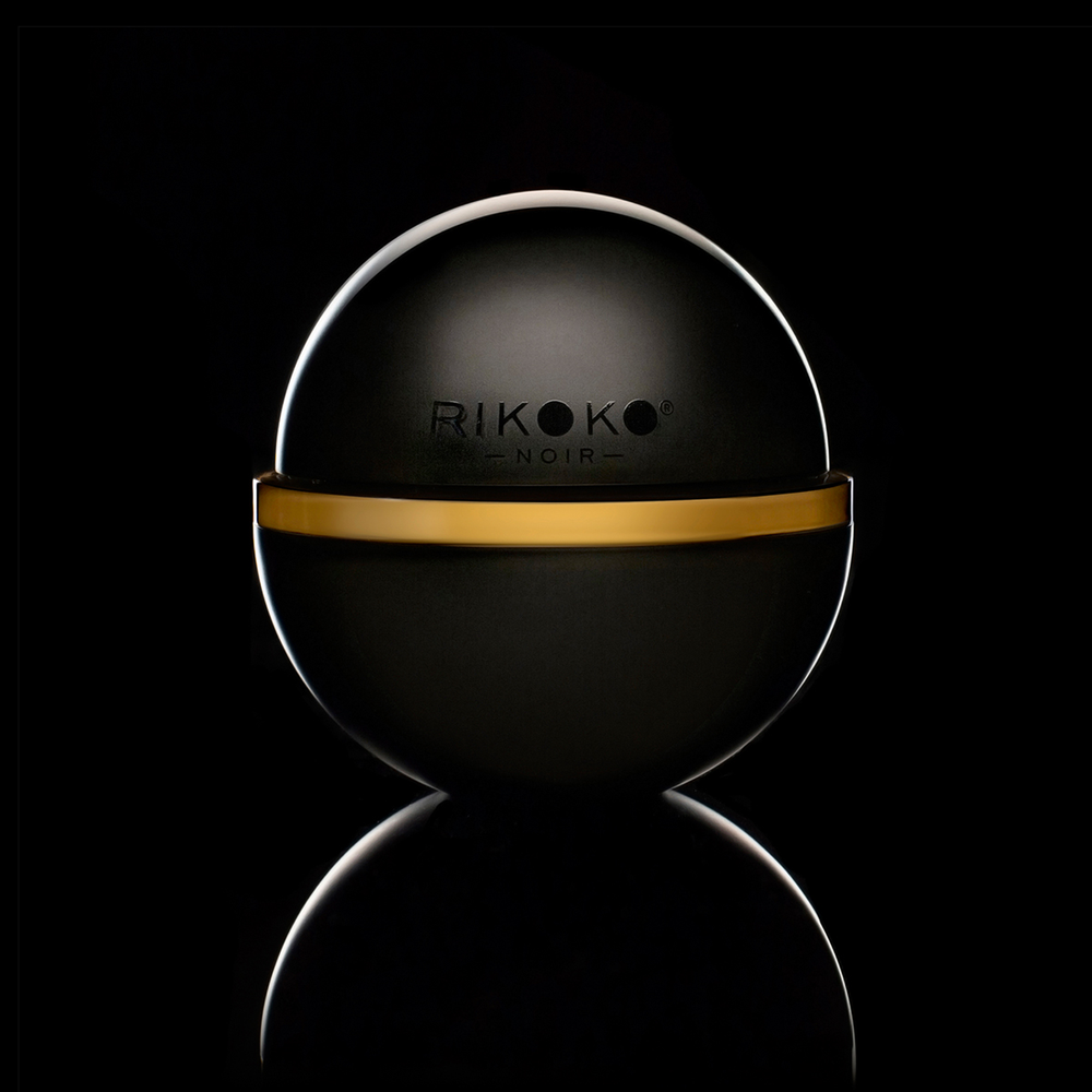Rikoko Noir Kokobalm can be used on curly textures to calm frizz and define curls, or brushed through straight hair for a polished look.