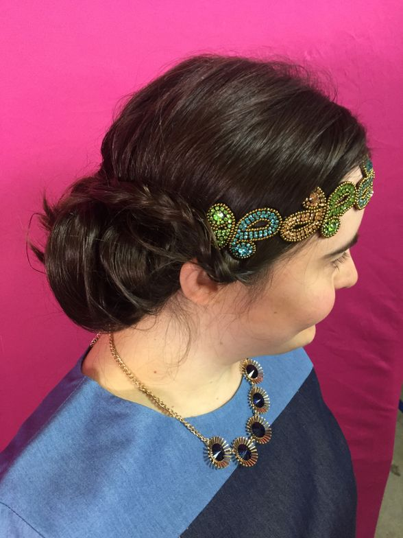 For Rachel's style, a tucked and rolled style was created around the base of her head. Tiny braids were added for more definition, and the Sydnie hairband added color.