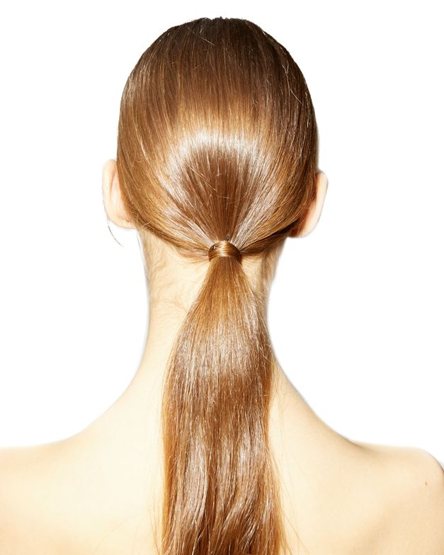 Low ponytails, such as this from PFW Valentino show, are a fashion week staple.