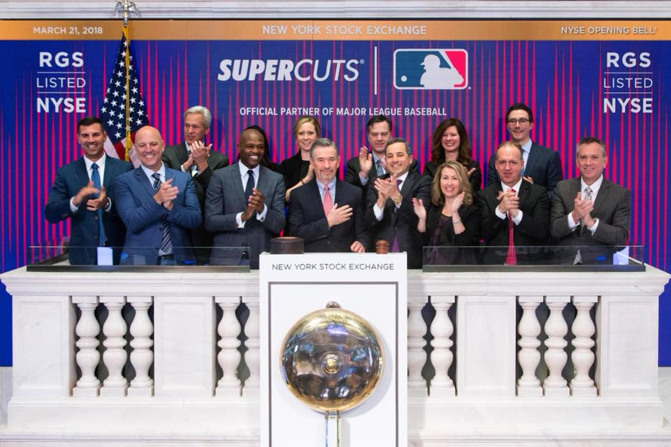 Representatives from Regis Corporation, Supercuts and MLB ringing the Opening Bell at the New York Stock Exchange on March 21, 2018. Regis Corp