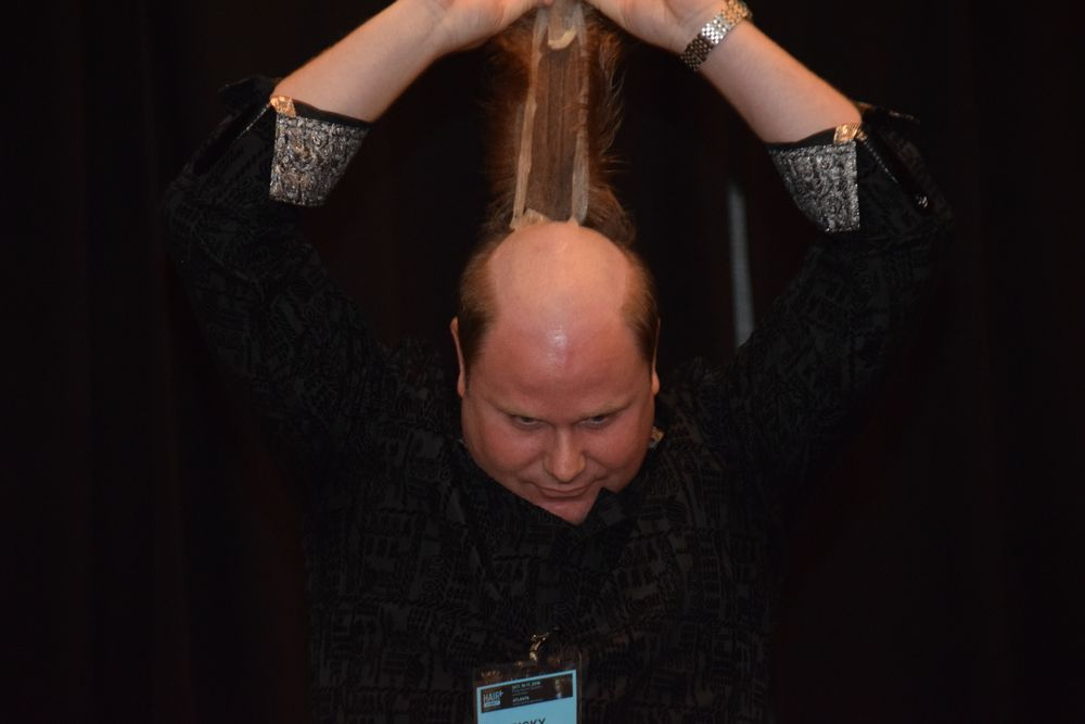 After networking with HAIR+ attendees for two days, Ricky Knowles, owner of Ricky Knowles Hair Wellness, shocked them when he took his hair piece off on stage. Many had no idea he used a hair system.