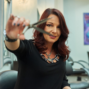 Rowena Yeager, owner of Studio Wish Salon in Twinsburg, Ohio, and her team retain clients with...