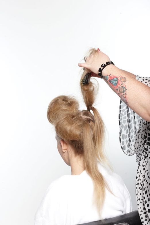2. Subsection by subsection, backcomb each ponytail to create volume and foundation.