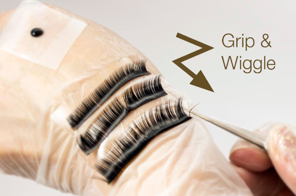 STEP 5: Using your Diamond Dusted Forceps remove extensions from a strip. Grip and wiggle down.