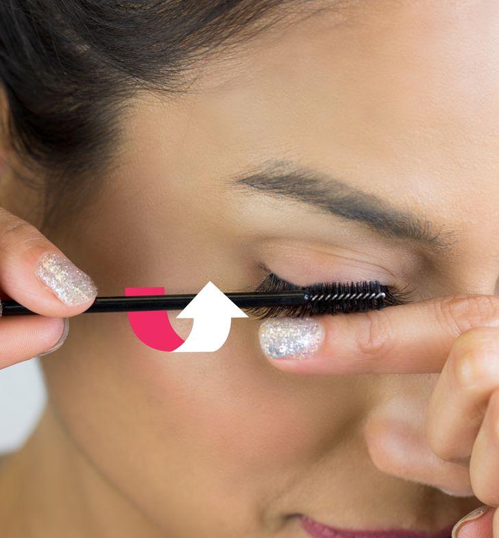 STEP 8: Using a mascara brush, comb the lashes rotating outward.