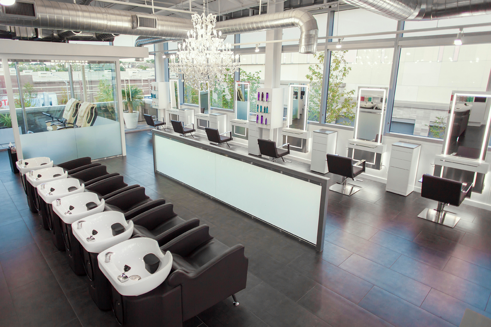 All four of the salon's exterior walls are glass, and offer views of Houston as well as the local upscale shopping center.