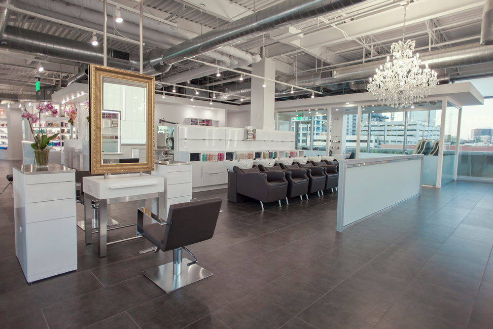 The salon has six shampoo stations and a color processing area.