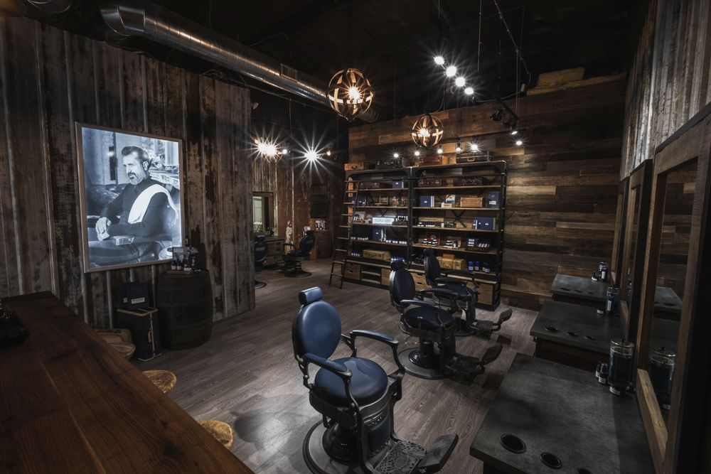 <p>Alternating walls of shiplap and aged metal barn siding creates a rugged, masculine feel within 1922 Men&#39;s Grooming.</p>