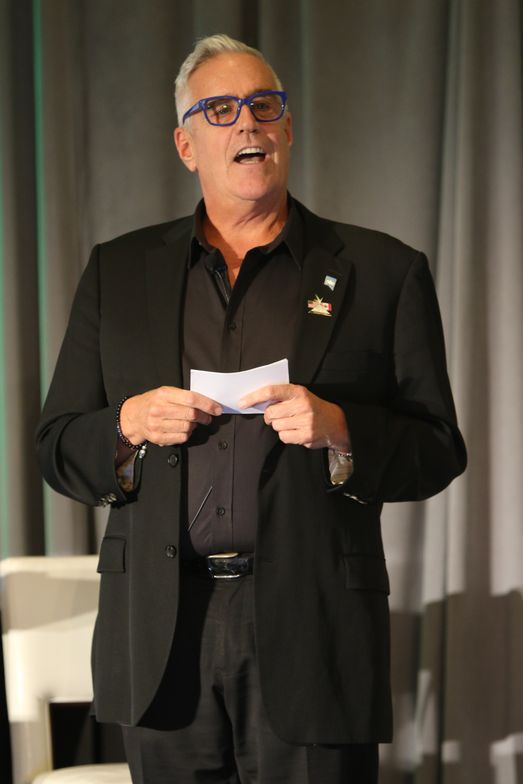 <p>Emcee Extraordinaire Scott Buchanan keeps data points top of mind for attendees.</p>