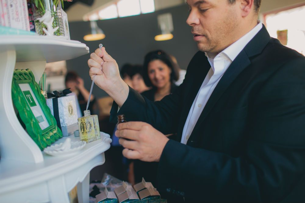 During the Salon Roux retail event, Sean OMara, founder of Royal Apothic, custom blends a fragrance for a client. Photo by Lindsey Gomes.