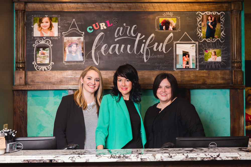 Wendy White McCown (center), owner of Signatures Salon in Lake Charles, Louisiana, flanked by her managers Noelle Mills and Bekah Nash.