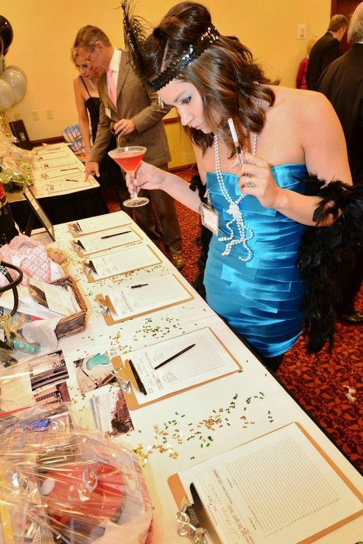 A guest at the Murder Mystery Dinner peruses the silent auction offerings.