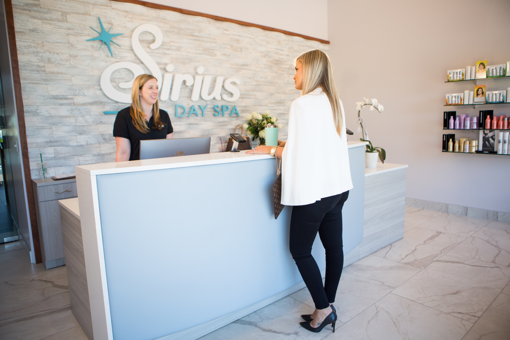 In the first zone at the front of the house, clients should be welcomed, given a moment to get into the mood for the service at time and have the chance to survey the retail area. (Front desk of Sirius Day Spa.)