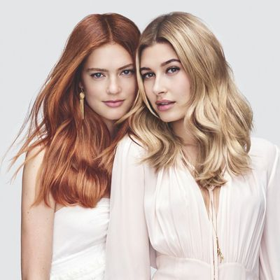 The model on the right shows off the new Copper Wave technique by <strong>L'Oréal Professionnel</strong>.