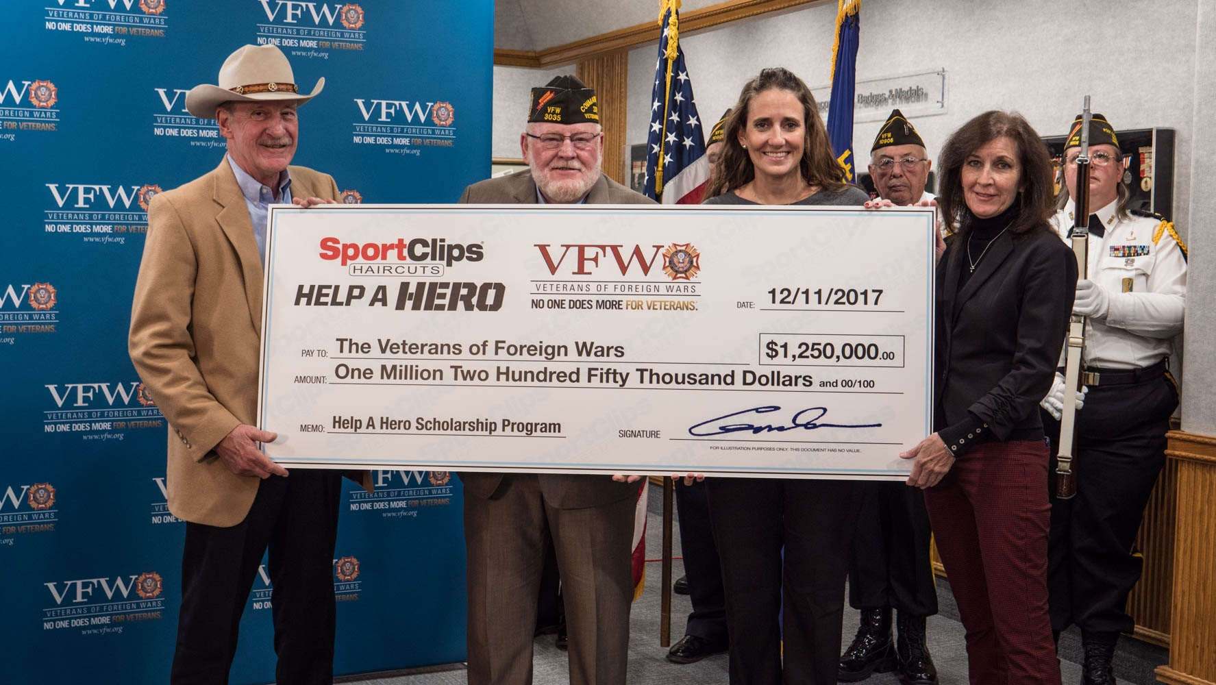 (L to R) Gordon Logan, Sport Clips Haircuts founder and CEO and an Air Force veteran, made the presentation to VFW National Commander Keith E. Harman; along with Amanda Palm, Sport Clips corporate communications manager, who oversees the Help A Hero program; and Martha England, Sport Clips vice president of Marketing.