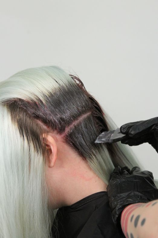 <strong>Step 1:</strong> Section the hair into thirds. Apply Root ChromaSilk Formula to the regrowth.