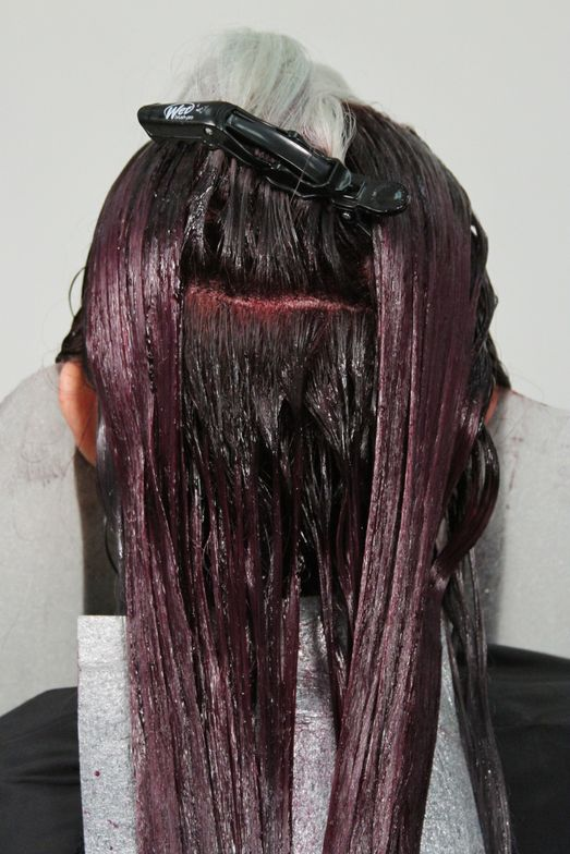 <strong>Step 3B:</strong> Part the hair into a triangular section, starting at the apex and ending at the bottom section. Sub-section the bottom half of your triangle and apply ColorLush Lavender Formula. Clip the top portion away.