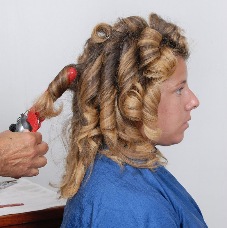 STEP 3: Starting at the nape, curl iron each ringlet holding iron on hair for minimum of 2-3 seconds each, then release. Repeat process until all hair has been ironed. Use a Tela styling product for final styling finish.