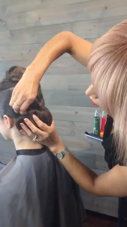 <strong>Step 4:</strong> Roll the ponytail up, smooth the exterior and secure to the head, expanding the sides of the chignon to cover any holes. Once you are happy with the shape of the chignon, move to the top section.