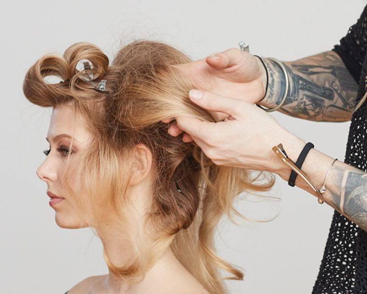 <strong>Step 7: </strong>Once you have worked around the entire head, use hands to free up the tease to make hair lively. Finish with <strong>Control Hairspray</strong>.