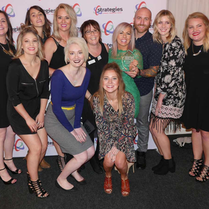 Harvey, in green, and the team from Studio7 Salon and Spa at Strategies' Team-Based Pay Awards.