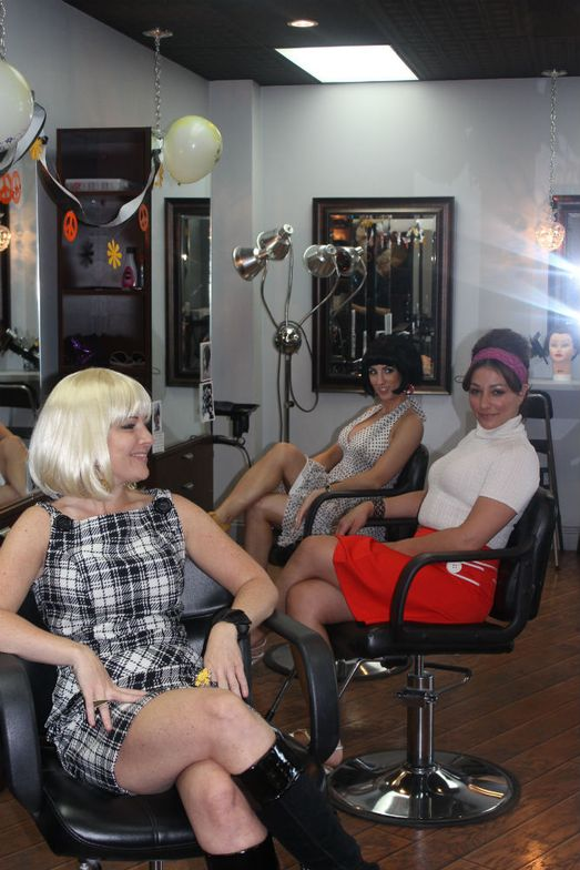 Stylist Heidi Agosto, Owner Christina Gengaro, and Stylist Tricia Ascolese show off their 1960s-inspired fashions.