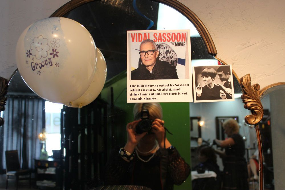 The staff decorated their mirror with iconic images of the life and work of Vidal Sassoon.