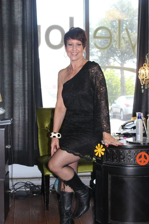 Receptionist Annie McVicar welcomed clients to the Style Lounge is 1960s style.
