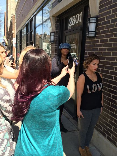 After each look, Chapman takes stylists outside to share the finer points of taking a perfect smartphone picture.
