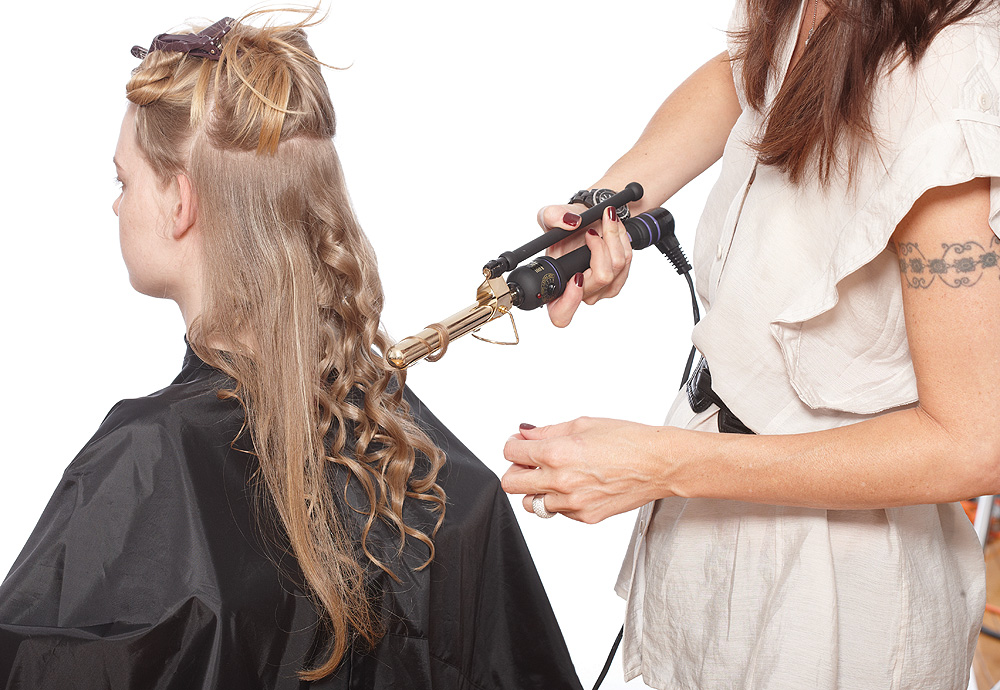 STEP 1: Take small sections and mist with Fortifying Heat spray. Using a ½-inch curling iron, wrap the section closest to the scalp to the right. Then wrap the mid shaft to the left, and wrap the last third to the right.
