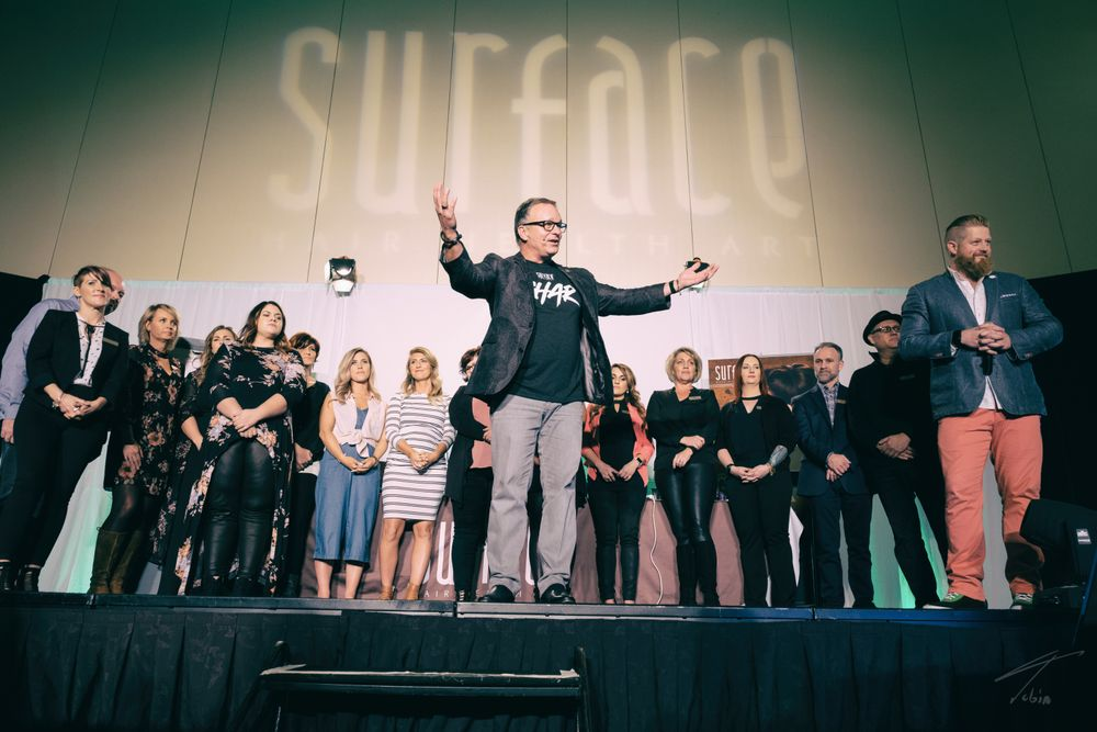 "<em>Members of <strong><a href=""http://www.surfacehair.com/"">Surface Hair</a></strong> management, artistic and salon teams joined together in Orlando, from Jan. 11-15, for education and connection<strong>.</strong></em>"