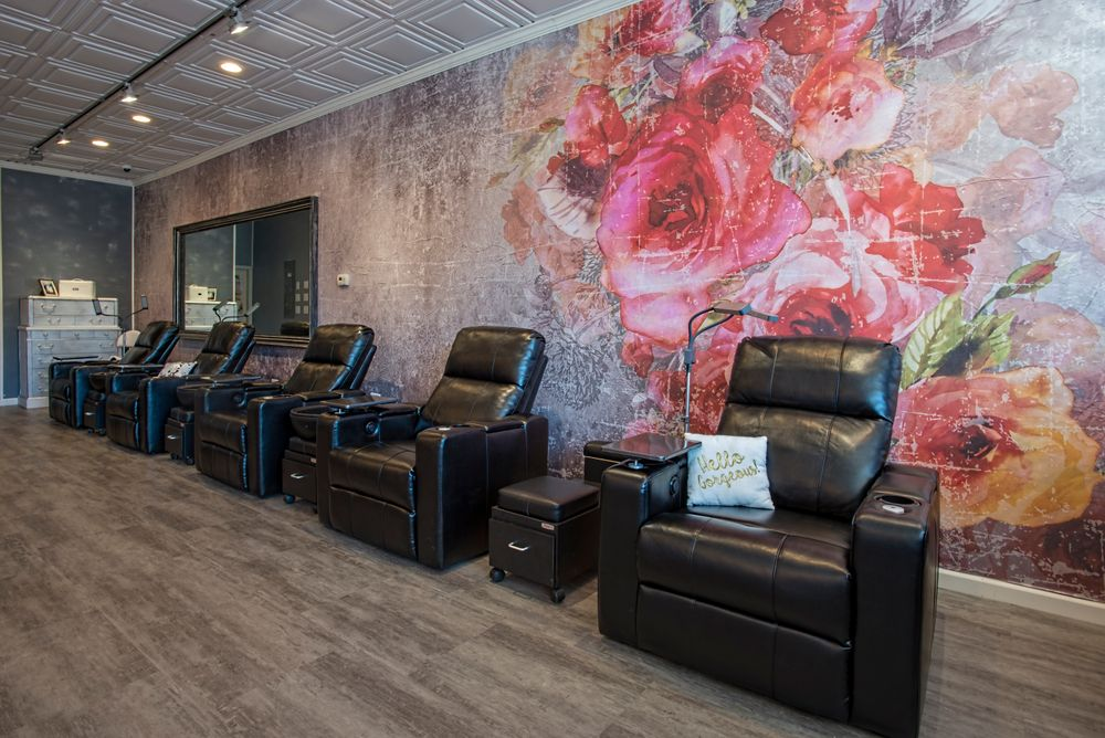 Matte black stations and extra large heavy framed mirrors on the styling side and comfortably large pedicure lounge chair in black vinyl on the nail care side provide a balanced contrast.