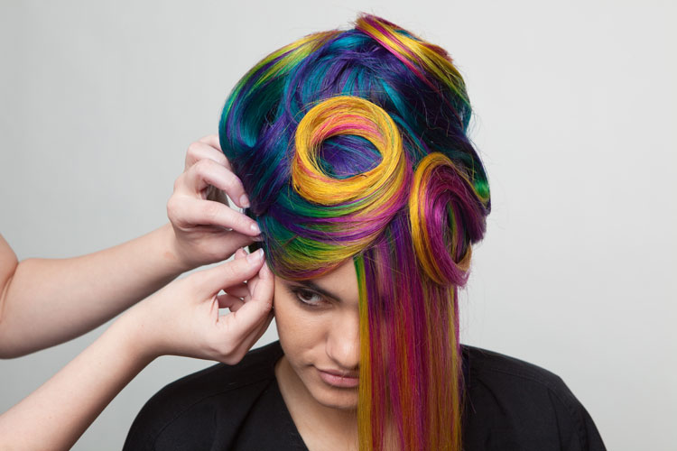 """6. Continue to create swirls, loops, and """"buns"""" around the head."""
