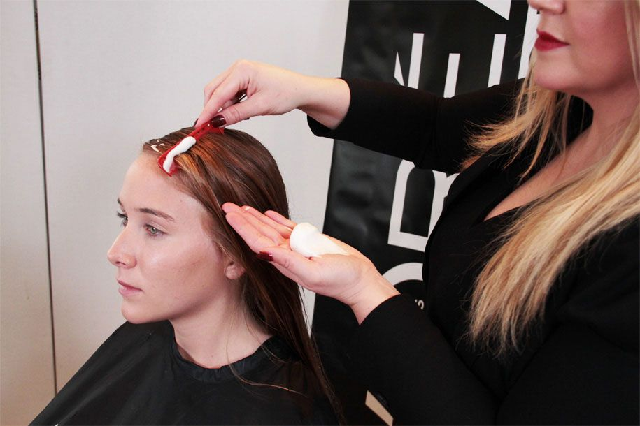 STEP 3: Spray L'Oréal Professionnel Infinium 3 from mid-lengths to ends to prep hair for curling iron.