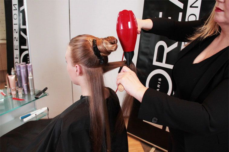 STEP 4: Curl hair section by section from mid-length to ends using a 1/2-1 in. curling iron.