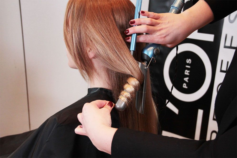 STEP 6: Dash a pinch of L'Oréal Professionnel True Grip to the same area that was backcombed to add texture then brush through while smoothing the part and sides of the hair.