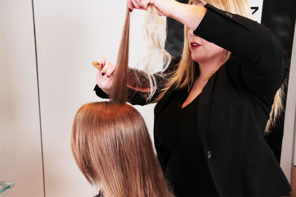 STEP 7: Using your fingers, brush hair to the middle of the head into a ponytail and secure with an elastic.